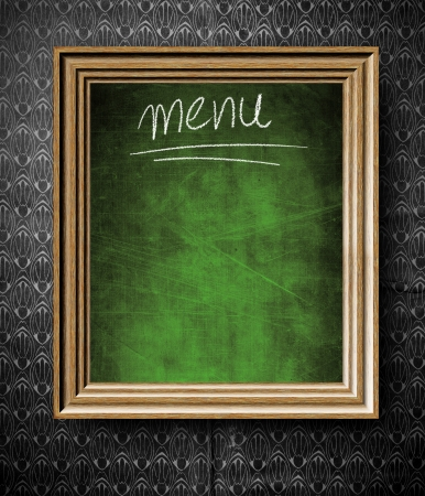Menu chalkboard with copy-space in old wooden frame on vintage wall photo