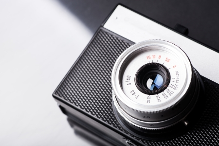 Old vintage camera on background with copyspace photo