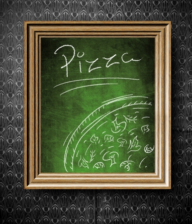 Pizza menu chalkboard in old wooden frame on vintage wall photo
