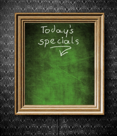 Todays special menu with copy-space chalkboard in old wooden frame on vintage wall photo