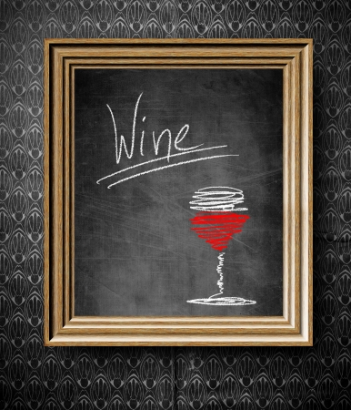 Wine menu chalkboard in old wooden frame on vintage wall photo