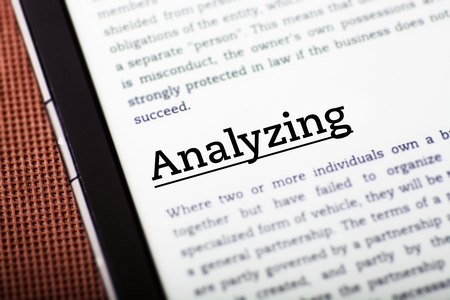 Analyzing on tablet pc screen, ebook concept Stock Photo - 23216711