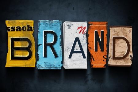 brand: Brand word on vintage broken car license plates, concept sign