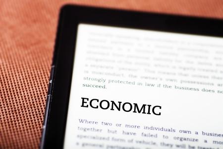 Economic on ebook, tablet pc concept Stock Photo - 23216926