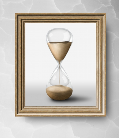 Elegant simple wooden frame with hourglass sand clock. Concept of passing time photo