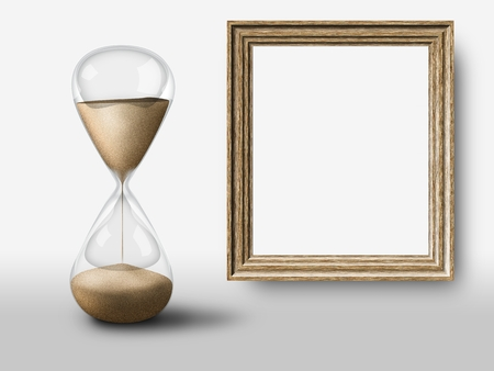 Elegant simple hourglass and vintage empty wooden frame. Concept of passing time