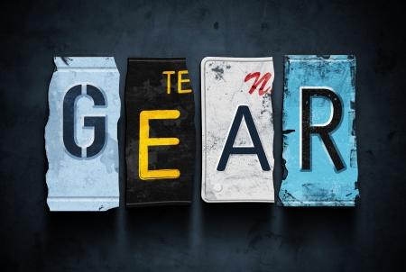 Gear word on vintage broken car license plates, concept sign photo
