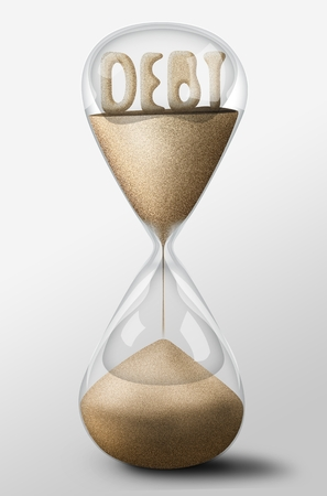 spending: Hourglass with Debt word made of sand inside the clock. Concept of spending money Stock Photo