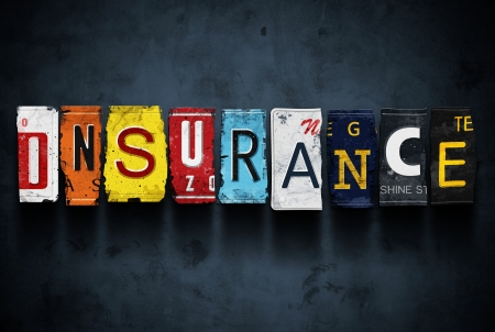 Insurance word on vintage broken car license plates, concept sign Stock Photo
