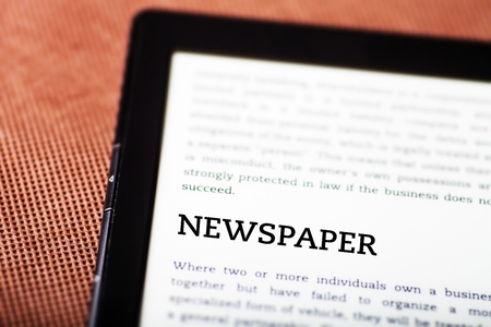Newspaper on ebook, tablet pc concept Stock Photo - 23190498