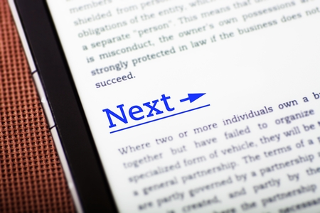 Next link on tablet pc screen, ebook concept Stock Photo - 23190499
