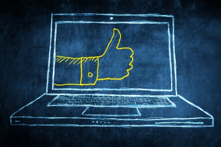 Sketch netbook computer screen, concept with hand showing thumbs up Stock Photo - 23190449