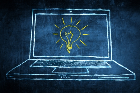 Sketch netbook computer screen, concept with idea light bulb Stock Photo