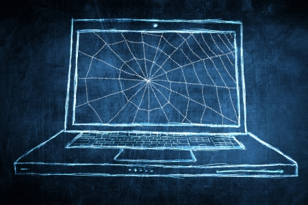 Sketch netbook computer screen, concept with spider web photo