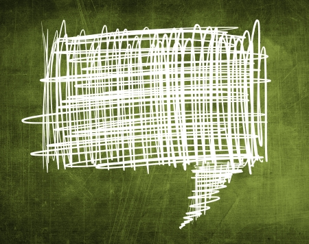 Sketch speech bubble on green chalkboard background Stock Photo