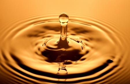 Water drop close up, orange background photo