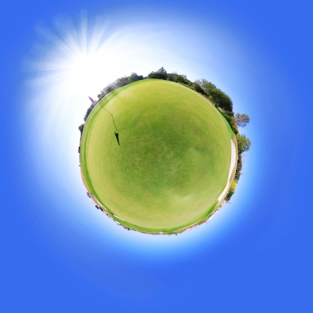 Little tiny planet golf course green field, Small world isolated Stock Photo - 23187503