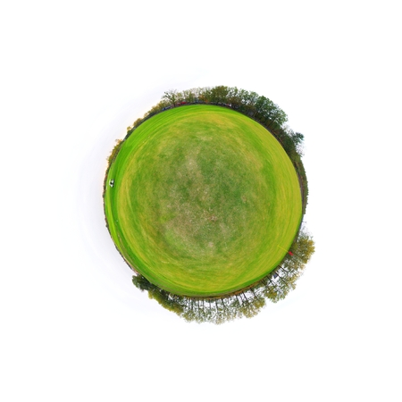 Little tiny planet with golf course green field, Small world isolated photo