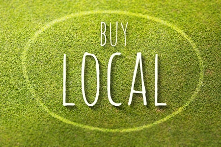buy local: Buy local on green grass poster, illustration of business Stock Photo