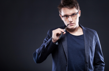 Elegant young man smoking electronic cigarette