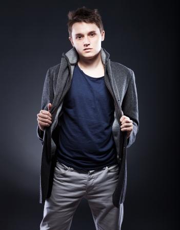 Handsome young man in winter coat