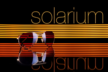 Solarium and sunglasses poster colorful lines on black