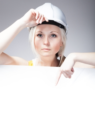 Young builder woman construction worker and empty banner photo