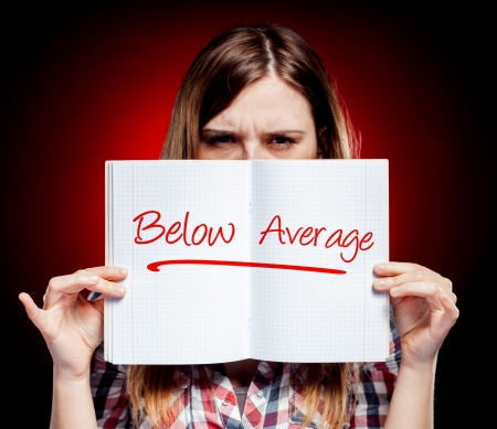angry teacher: Evaluation below average and angry woman