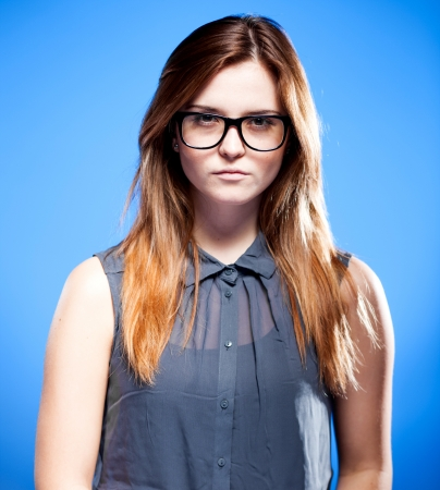 objections: Focused young woman with large nerd glasses, strict girl