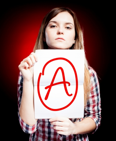 Perfect school grade A of exam and proud woman photo
