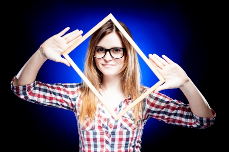 cropping: Smiling woman with large nerd glasses and frame around her face