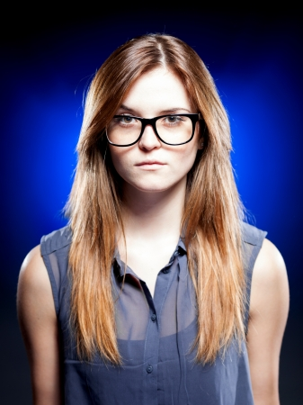 Strict young woman with large nerd glasses Stock Photo