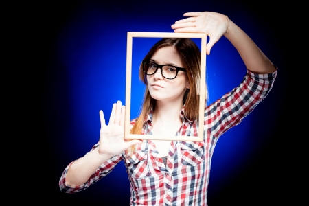 Woman with large nerd glasses and frame around her face Stock Photo