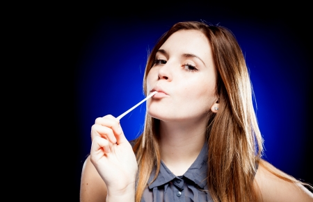 Attractive young woman with chewing gum photo