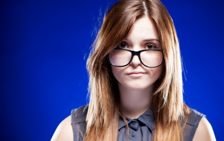 unsatisfied: Disappointed young woman with large nerd glasses, strict girl