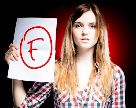 Failed test or exam and disappointed woman Banco de Imagens - 25044944