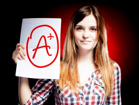 Perfect school grade A plus of exam and happy woman Stock Photo