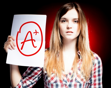 Perfect school grade A plus of exam and proud woman photo