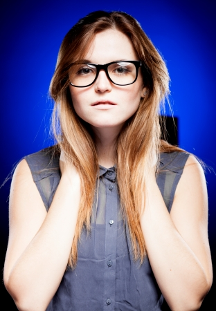Portrait of strict young woman with large nerd glasses photo