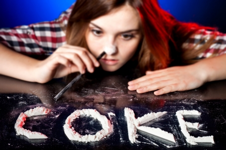 druggie: Woman snorting cocaine or amphetamines, symbol of coke addiction