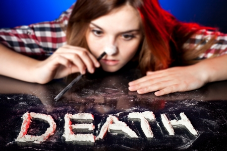 druggie: Woman snorting cocaine or amphetamines, symbol of death