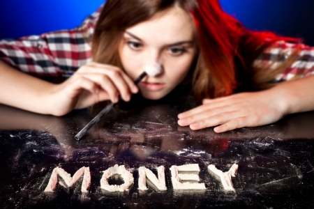 druggie: Woman snorting cocaine or amphetamines, symbol of money addiction Stock Photo