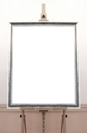Empty frame on painting easel, blank background photo