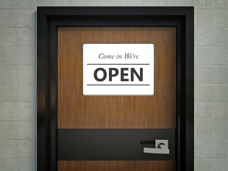 come in: Come in we are open sign hanging on a office door Stock Photo