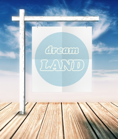 dream land: Dream land concept poster hanging on clouds background Stock Photo