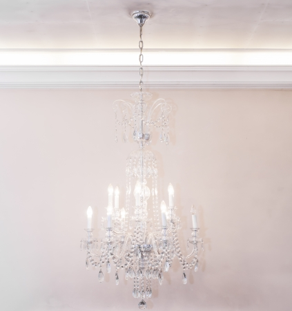 Crystal chandelier hanging on the ceiling photo