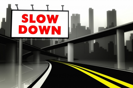 slow down: Slow down road sign on highway in conceptual big city Stock Photo