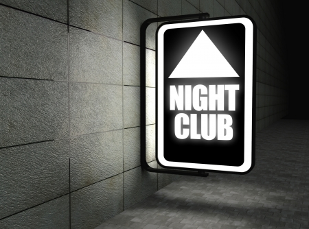Glowing night club sign at night on street photo