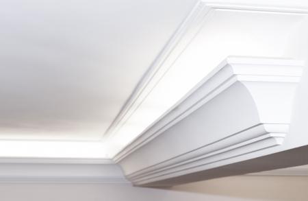 Illuminated cornice, bright and clear interior background