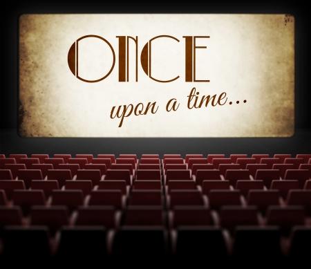 Once upon a time filmscherm in oude retro bioscoop, bekijken van publiek Stockfoto